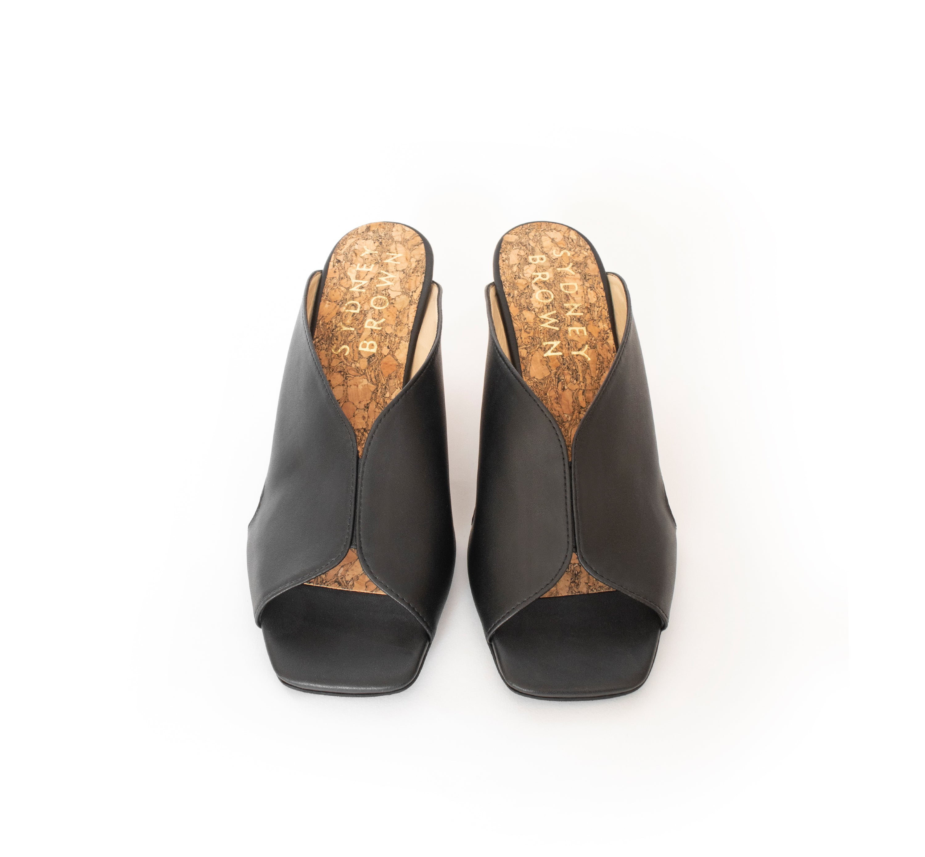 High Heel Mules in certified black faux-nappa and breathable lining, natural wood heel. Luxury vegan heels. Sydney Brown Spring Summer 2019. Sustainable, eco-friendly fashion