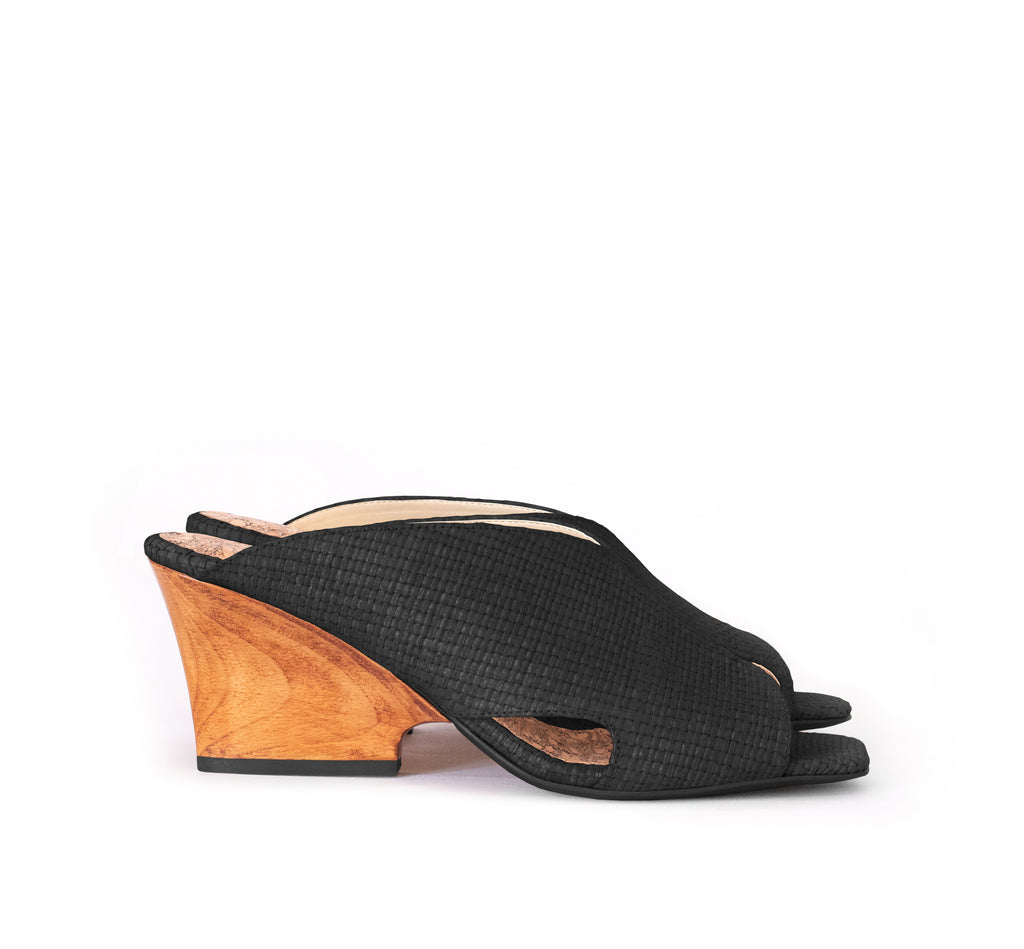 Black raffia mule slide with a curved design high heel in dark cherry brown wood.
