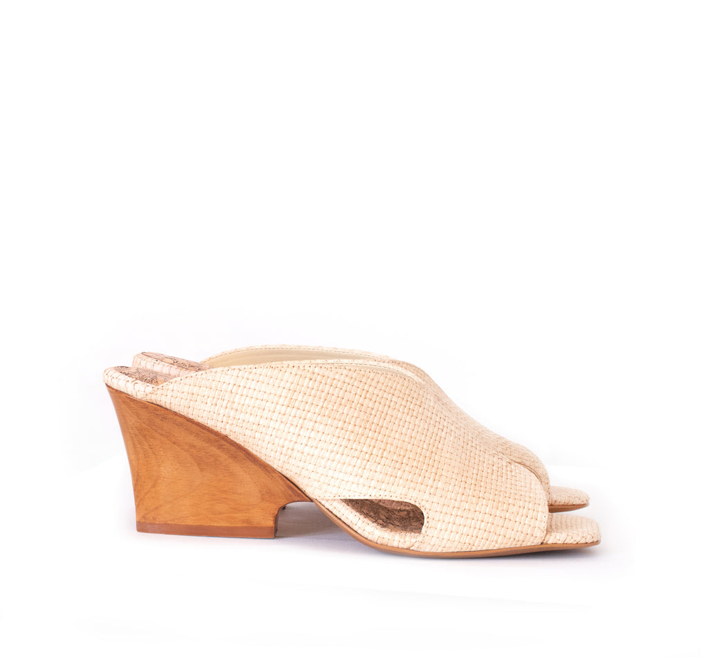 Natural raffia mule slide with a curved design high heel in dark cherry brown wood.