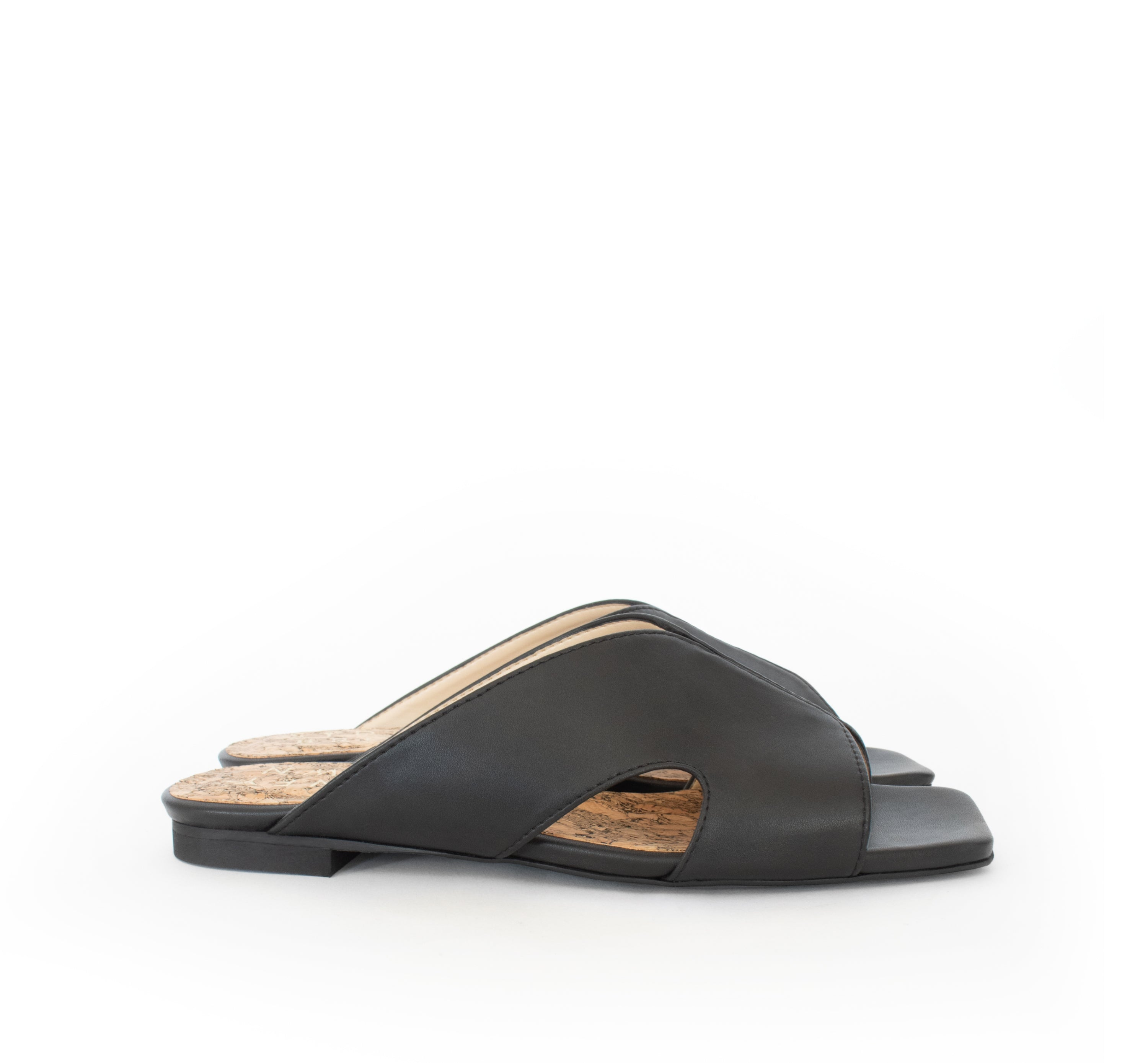 Circle Slides in eco black faux-nappa and breathable lining. Luxury vegan flats. Sydney Brown Spring Summer 2019. Sustainable, eco-friendly SS19 fashion