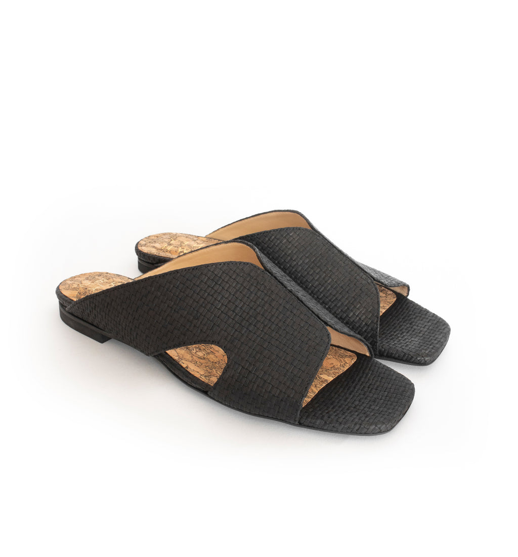 Black raffia slide with a black flat sole.