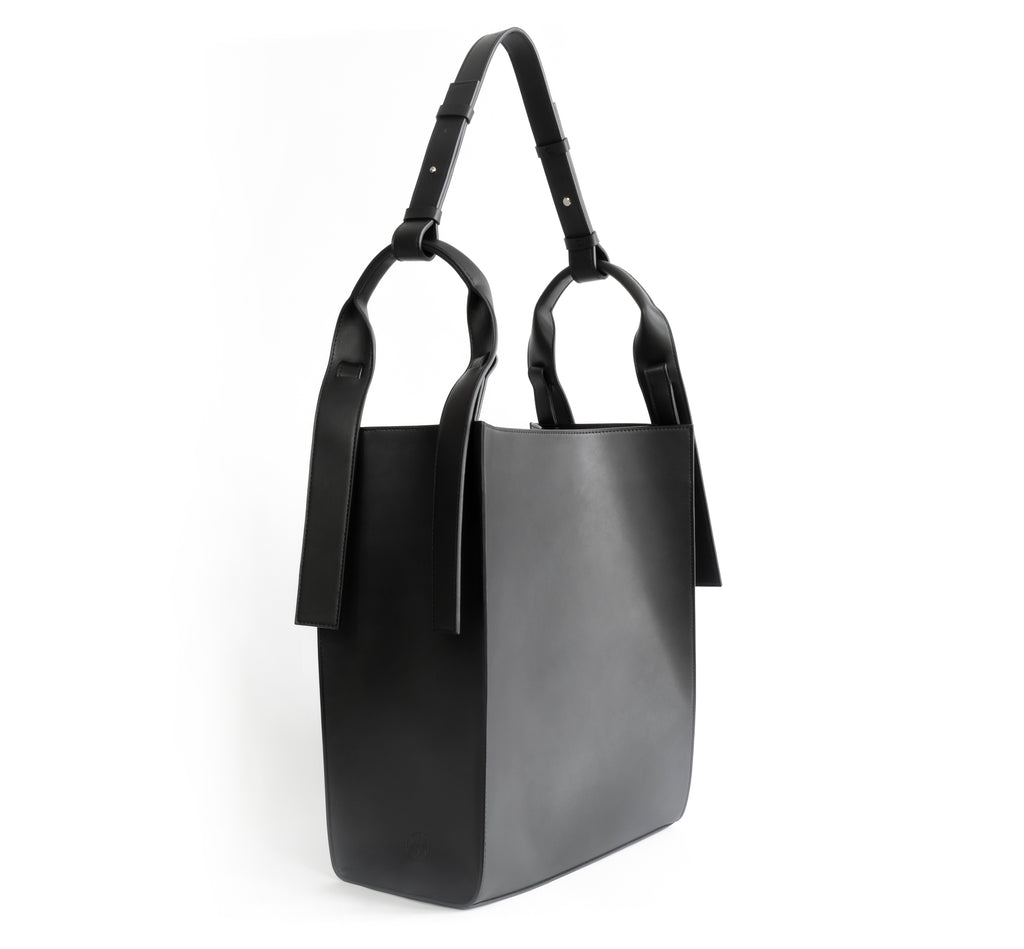 Black eco vegan leather tote shoulder bag by Sydney Brown. Timeless, classic and modern.  Angle View.