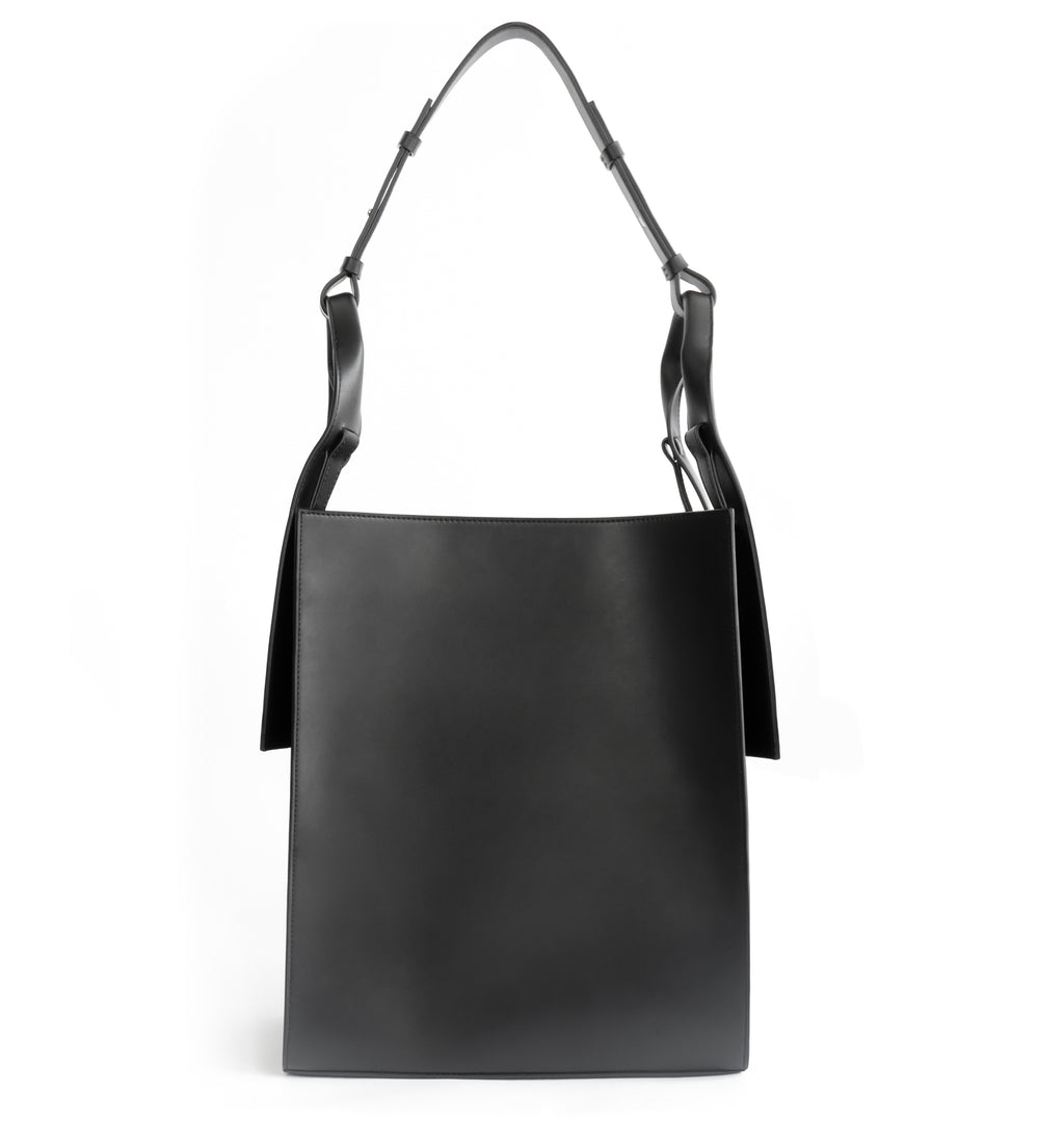 Black eco vegan leather tote shoulder bag by Sydney Brown. Timeless, classic and modern.  Front View.