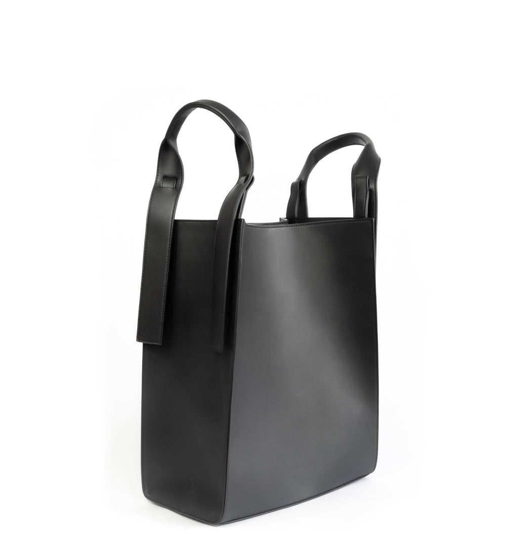 Black eco vegan leather tote shoulder bag by Sydney Brown. Timeless, classic and modern.  No shoulder handle.