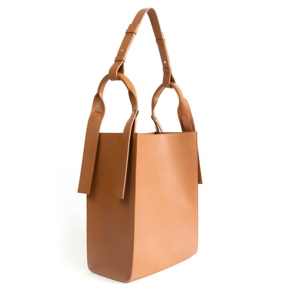 Brown eco vegan leather tote shoulder bag by Sydney Brown. Timeless, classic and modern. Angle view.