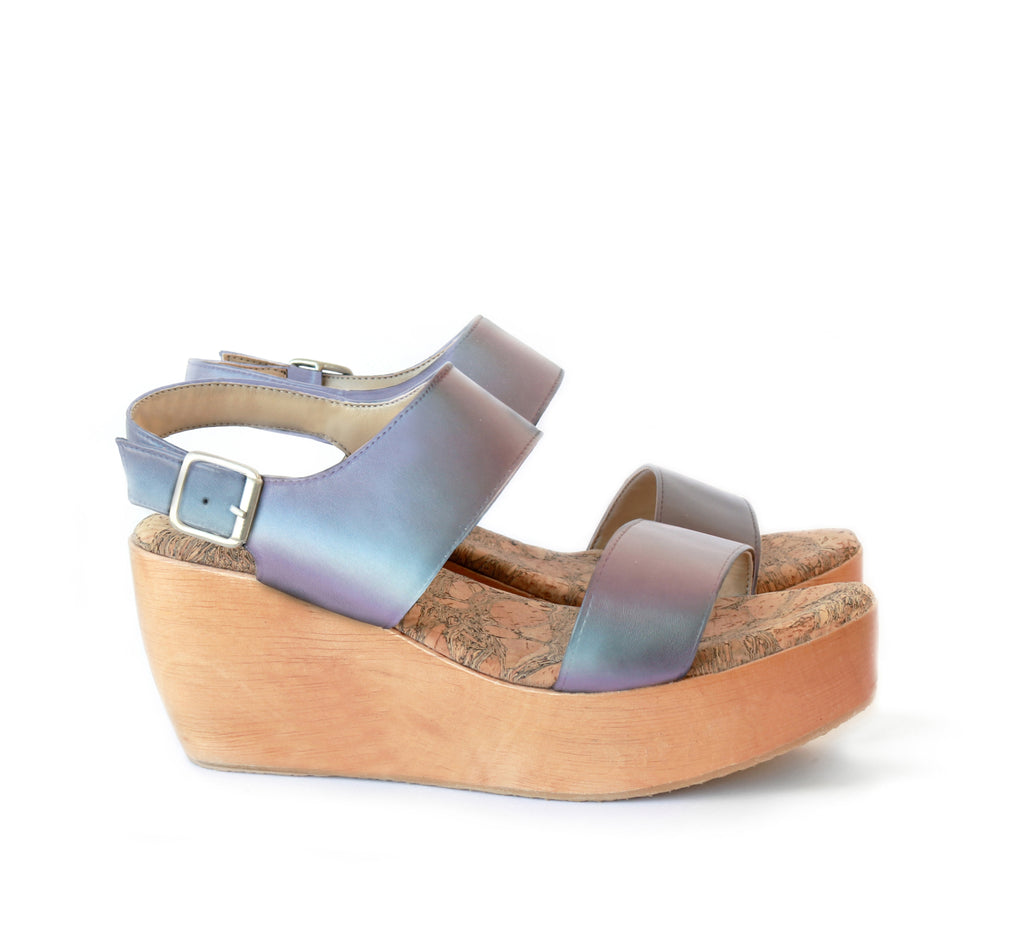 Sandal with two straps, matte iridescent vegan leather with a natural wood platform.