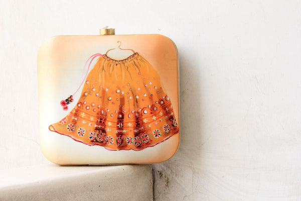 Gold peach Lehenga Clutch