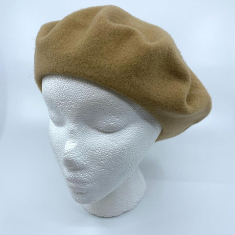 a sand coloured tam/beret on a mannequin head