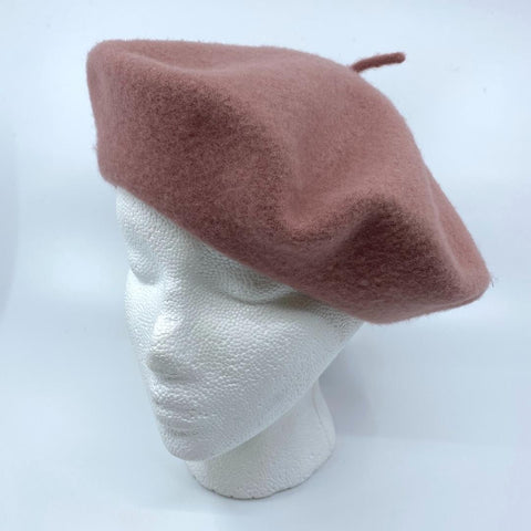 a dusty rose coloured tam/beret on a mannequin head