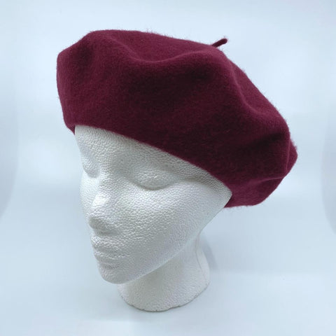 a wine coloured tam/beret on a mannequin head