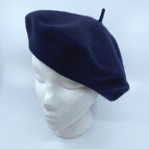 a navy tam/beret on a mannequin head