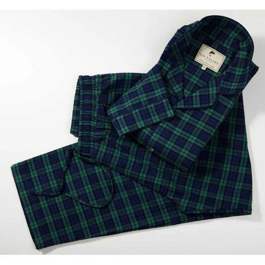 dark green and blue tartan pyjamas on a white backdrop