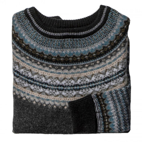 The Colliery Alpine Sweater detail shot. The main body of the sweater is charcoal grey and features fairisle knit collar and cuffs in charcoal, biege, blue and black.