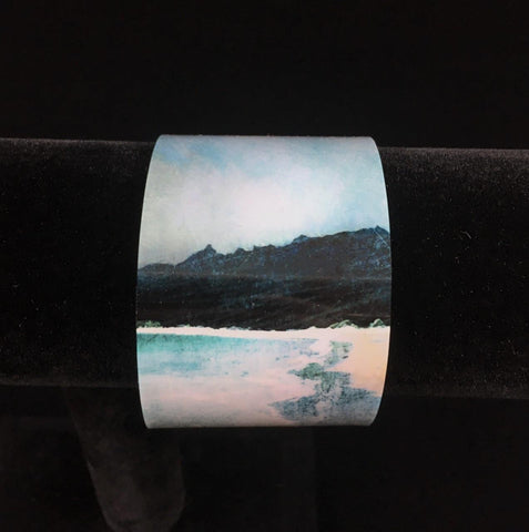 detailed image of the reef beach landscape painting on a wide bangle bracelet