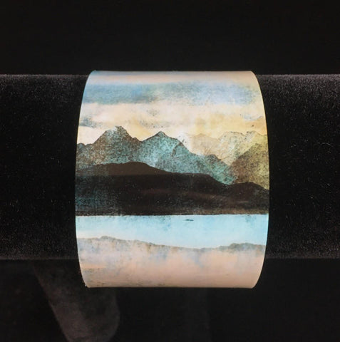 abstract landscape of Skye from Bealach Na Ba Applecross printed on a wide bangle - mountains in black and green over a lake of blue and pink