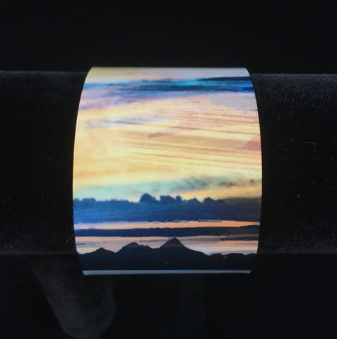 detail of the Western Isles from Trotternish bangle - black and blue mountains sit against a yellow and orange sky
