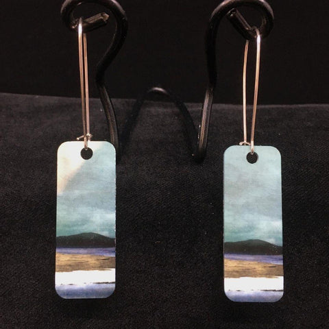 detail image Salt Marshes earrings - a beautiful blue skies with a black rocky outcrop silhouetted