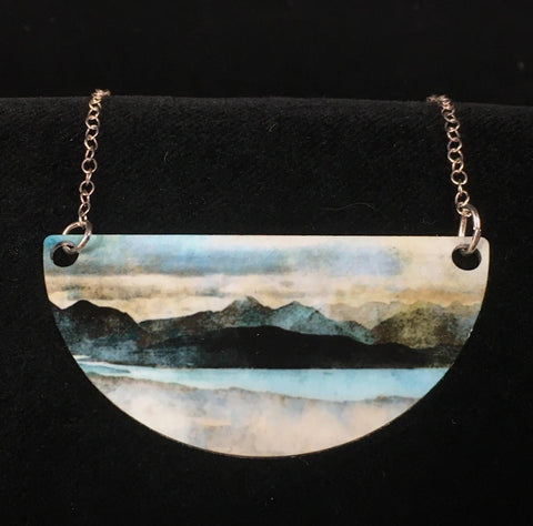 detail image of Skye from Bealach necklace - blues, greys, and cream yellows create an abstract landscape of mountains, water, and sky