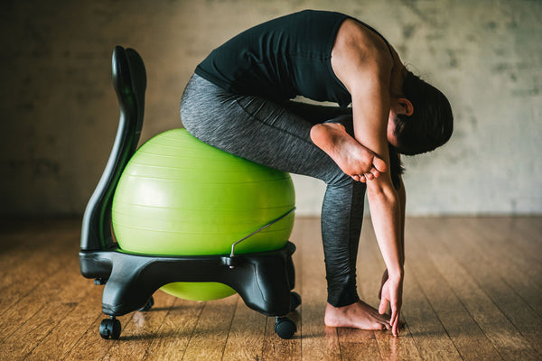 & 3 Stretches to Beat Back Pain without Getting Up from Your Chair - Gaiam