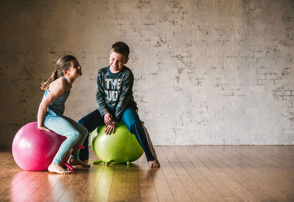 How Sitting on a Ball Helps Kids Focus and Do Better In