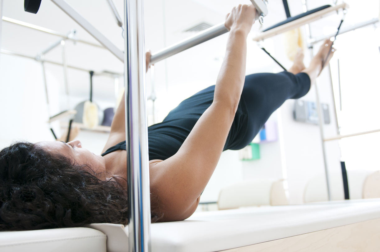 Should You Do Pilates on a Mat or on a Reformer?