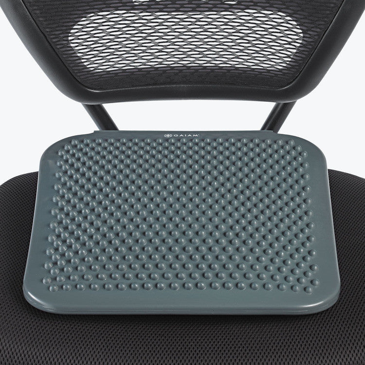 Turn any chair into an active one with this Gaiam Active Sitting Posture Improving Balance Wedge. With a uniquely textured surface and air fill, this cushion forces you to balance, inspiring small micro-movements that strengthen your core, improve posture and increase blood circulation. The angled back elevates your body, properly aligning your spine for a better posture while you sit.