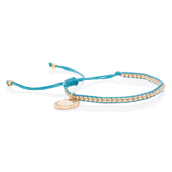 Pulsera Gold Power. Color Aguamarina