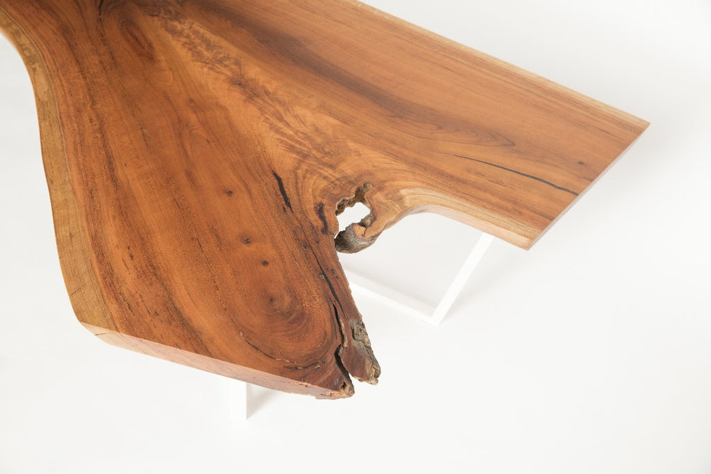 Cherry Slab Coffee Table with white intersection base detail view of grain pattern