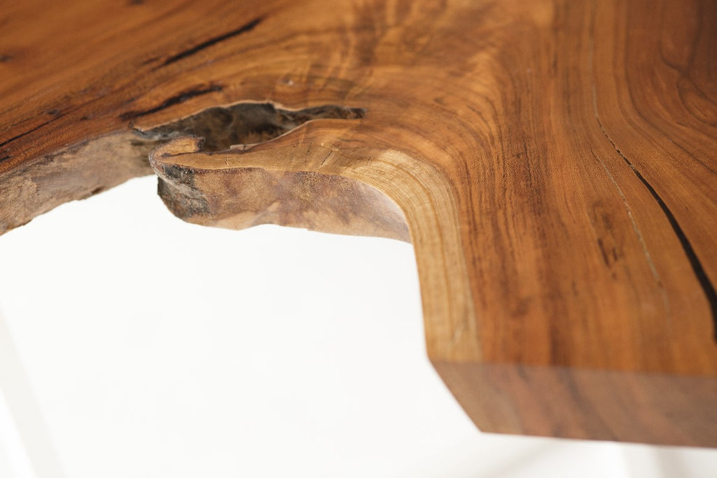 Cherry Slab Coffee Table with white intersection base detail view of live edge