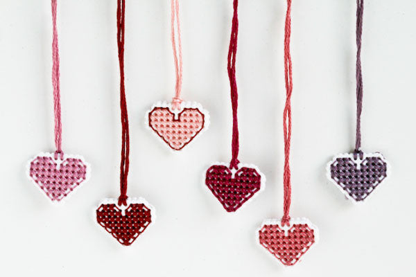 Cross stitch heart charms for Valentine's Day - so quick you can make a whole batch