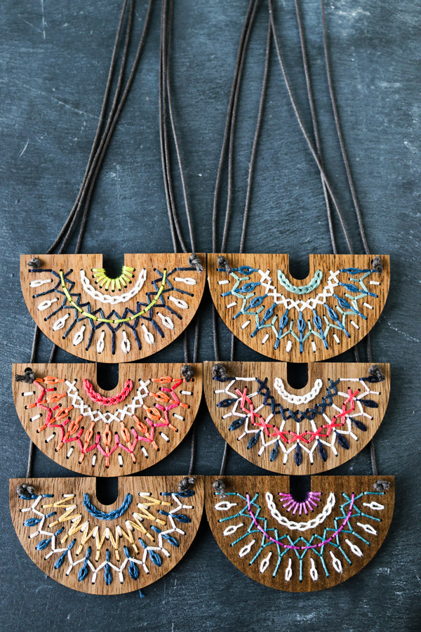Hand embroidered wood necklace kit by Red Gate Stitchery