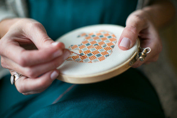 in my studio there is a drawer full of completed cross stitch patterns that have yet to be turned into pillows or framed for the wall or sewn up into cute