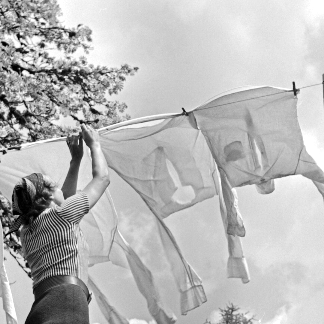Image of a washing line with shirts on it from the 1940s