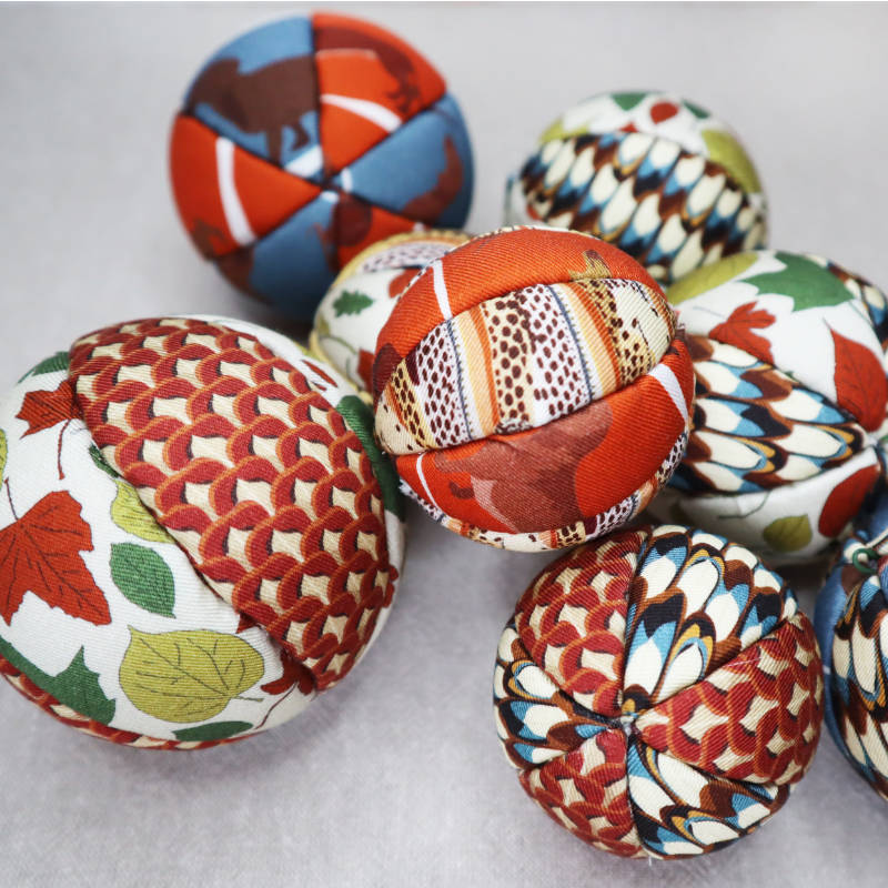 Photo of a group of fabric christmas baubles.