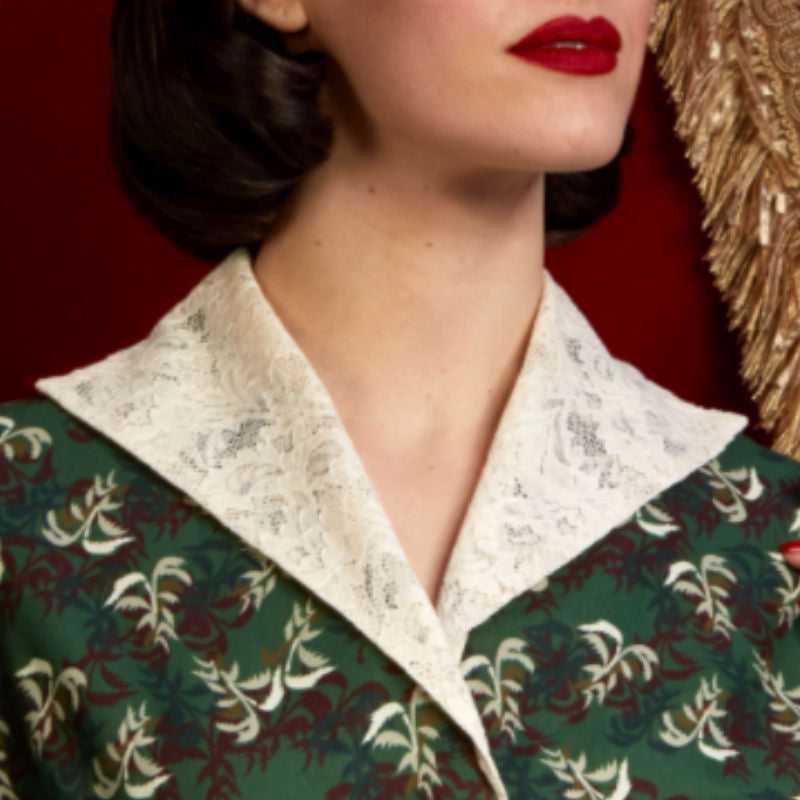 picture of an english lace collar on our Betsy dress in front of red velvet curtains