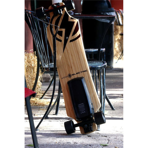 Atom Long Boards  H10 Electric Skateboard - Leaning Against a Chair