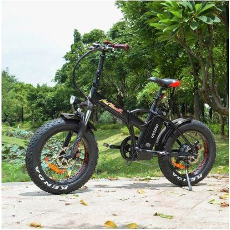 Black AddMotor Motan M150 P7 - Folding Fat Tire Electric Bike - On Sidewalk