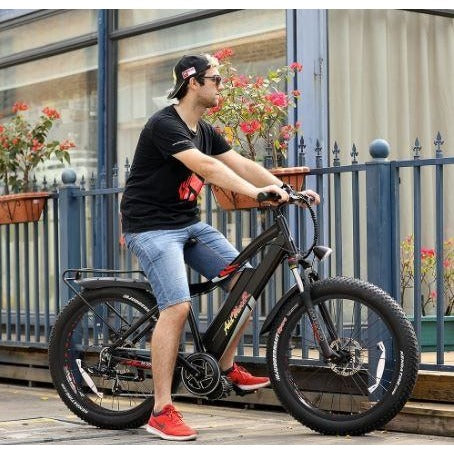 Black AddMotor Motan M5800 - Fat Tire Electric Bike - Outside with Rider