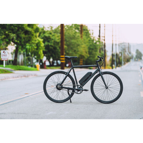 Black Populo Sport V3 Electric Commuter Bike - In the middle of the street