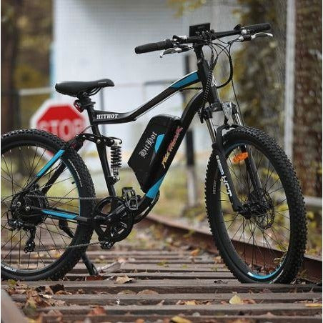 Blue AddMotor HitHot H1 - Electric Mountain Bike - on train tracks