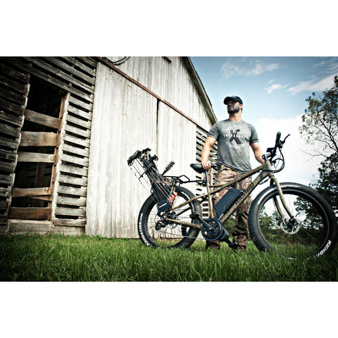 Rambo 750W Mossy Oak Camo - Fat Tire Electric Mountain Bike - Outside of a barn