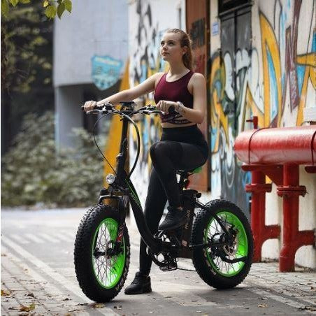 Green AddMotor Motan M140 - Folding Fat Tire Electric Bike - with rider outside