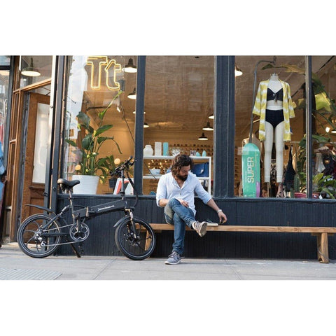 Joulvert Stealth - Folding Electric Bike - In front of a store