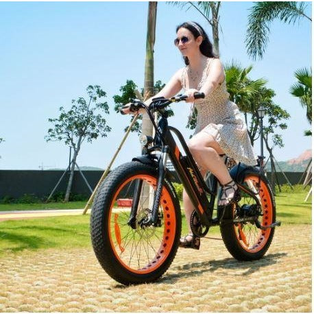 Orange AddMotor Motan M450 - Fat Tire Electric Bike - Female Rider on Bricks
