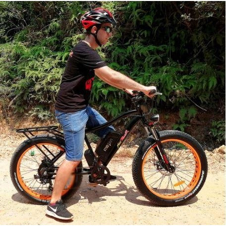 Orange AddMotor Motan M550 750W - Fat Tire Electric Bike - Driving on Dirt Road