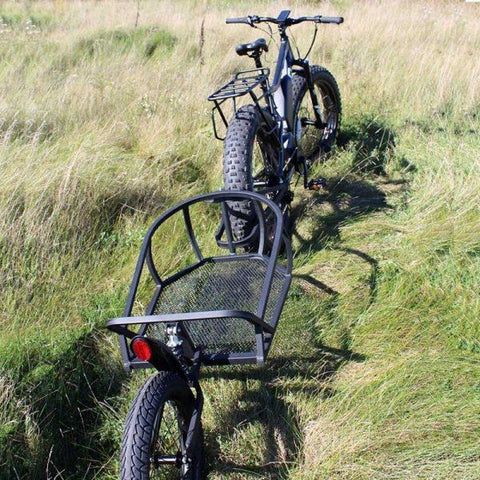 Rambo Bikes - Single Wheeled Cart - Attached to E-Bike in a field
