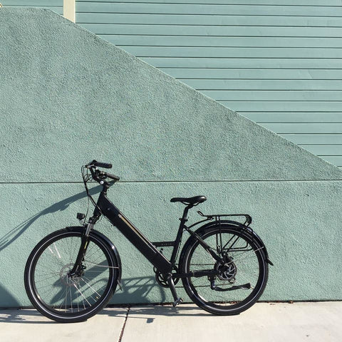 Black Espin Flow - Electric Bike Commuter - Against Wall