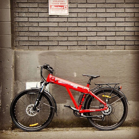 Red Shocke Bikes Spark - Electric Bike - Against Brick Wall
