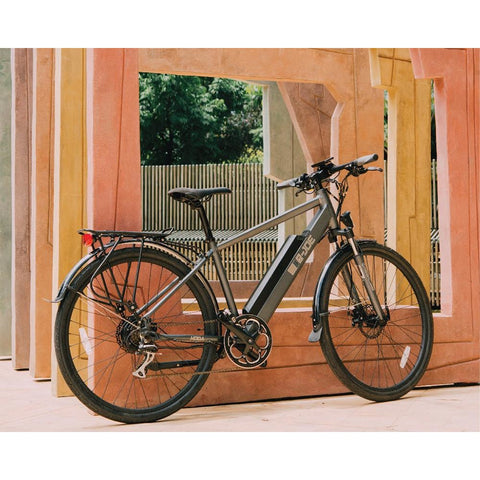 Grey e-Joe KODA Sports Class - Electric Commuter Bike - Leaning against wood panels