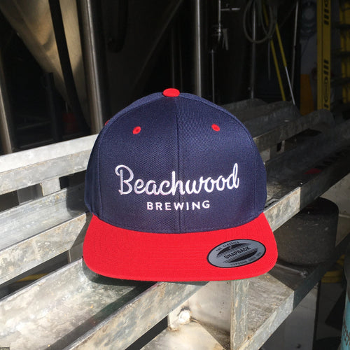Beachwood Brewing White Logo Snapback hat in Navy and Red.